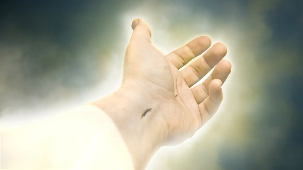 Jesus' resurrected hand bearing nail wound reaching out.